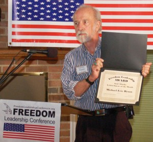 "David Denholm displays the Certificate that he will mail to Michael Eric Dyson of MSNBC TV as the July ""Saul Alinsky Smear Conservatives"" award winner at the Freedom Leadership Conference.  The next Conference and a new ""winner"" will be announced on August 21 in Northern Virginia."