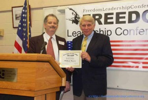 """Freedom Leadership Award"" presented to keynote speaker William Murray by Conference Event Coordinator Richard Buck."
