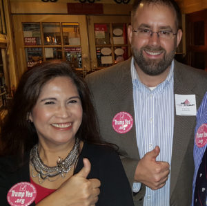 "Corey Stewart Campaign Manager Spence Rogers (center) gives a ""thumbs up"" that he has the 2/16 conference on the Corey Stewart schedule at his candidate announcement event recently, with Conference Chairman Emy Delgaudio, wearing the new ""Trump Yes"" button of conference co-sponsor Americans for the Trump Agenda."