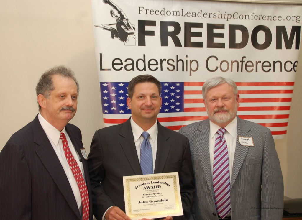 "John Guandolo (center), keynote speaker at the June 12 Freedom Leadership Conference, being presented the ""Freedom Leadership Award"" by Conference Event Coordinator Richard Buck (L) and Conference Master of Ceremonies Richard Conn (right).  The link to his remarks - both video and the text - are to be found in this article."