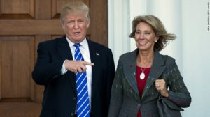 Betsy DeVos with President Donald Trump after she was announced as his nominee for Secretary of Education.